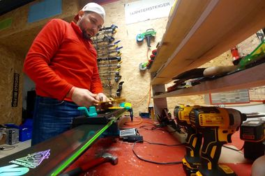 Nick Dumitru mounts a binding on a ski at Chicago Ski Pro, 4837 W. Irving Park Road.