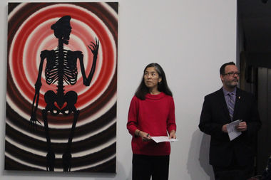 Public Health Commissioner Julie Morita and Deputy Commissioner David Kern prepare to release the city's annual HIV/STI Surveillance Report at the Art AIDS America exhibit at the Alphawood Gallery Thursday. They're standing next to Roger Brown's