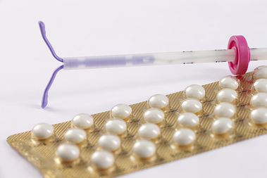 A type of IUD and the pill.