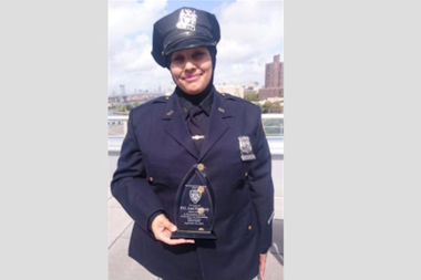 Officer Aml Elsokary, seen here after being awarded a medal for her bravery, was harassed and threatened on Dec. 3 by a man in her home neighborhood of Bay Ridge, police said.