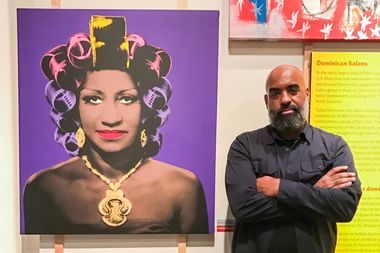 Uptown artist, M. Tony Peralta, poses before his