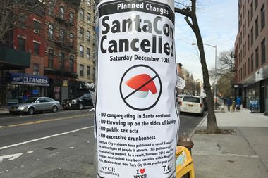 Posters advertising the cancellation of SantaCon were found on some East Village streets Friday morning.
