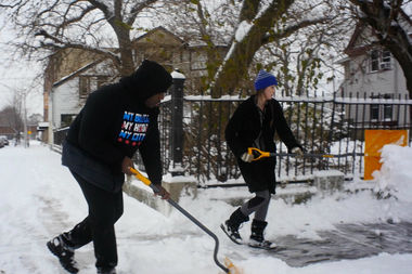 A handful of volunteers gathered in the streets of Englewood to shovel snow in a neighborhood of elderly residents.