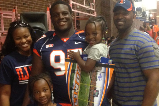 Vontrell King-Williams with his parents, Jemal and Camille, and sisters, Jasmine, Ayanna (bottom left) while he was a member of the University of Illinois football team