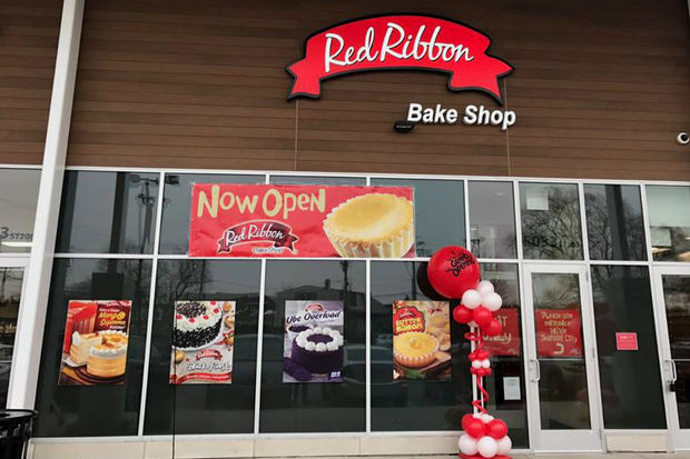 Red Ribbon Draws Lines For Grand Opening Despite Snow