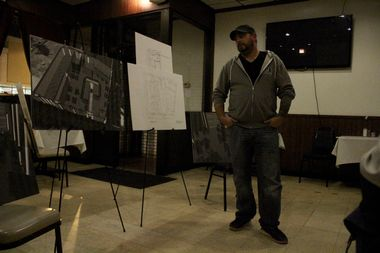 Gus Karamaniolas shows preliminary plans for the interior of Fischman's Public House at Monday's meeting.