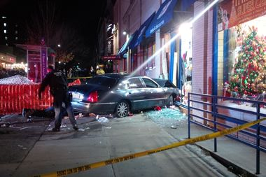 A car plowed into a discount store on Ninth Street and Fifth Avenue at about 5:24 p.m., the FDNY said.