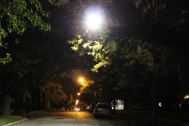 The city's new LED lights (foreground) shine whiter than the yellow lights now around the city.
