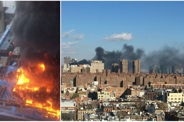 The fire spewed a cloud of black smoke over lower Manhattan, witnesses said.