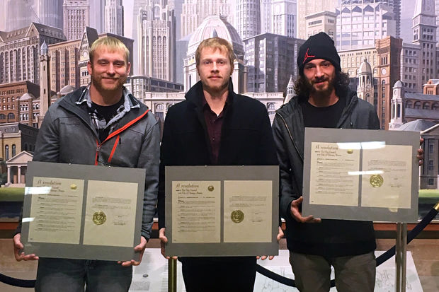 Movers Josh Lara, Cody Grant and Mike Zaininger were honored by City Council Wednesday. In October, they may have saved a woman's life by helping her hide in their truck while her armed ex looked for her at the West Loop dental office where she worked.