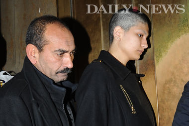 Yasmin Seweid exits the Manhattan Criminal Court with her father after her arraignment on Wednesday, December 14, 2016.