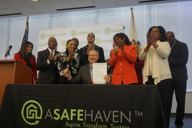 Gov. Bruce Rauner sings into law a bill that will give ex-inmates state IDs Thursday in North Lawndale.