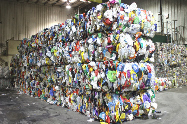 Paper Plastic And Metals Are Separated At The Recycling Center Processed Into Bales Of Like Materials When Bags Clog Sorting Equipment