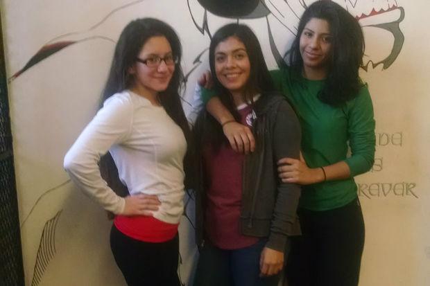 The Lake View High School varsity wrestling team features three girls: Dulce Reyes, Vanessa Munoz and Daniela Garcia.