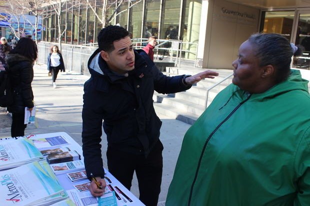 Erik Perez, a Medicare representative  with MetroPlus gives someone information about signing up for Obamacare on in front of Gouverneur Health at 227 Madison St. on the Lower East Side.