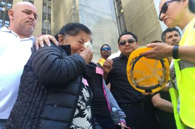 Workers' rights advocates presented Carlos Moncayo's mother with a hardhat after the Harco conviction, vowing to keep fighting for justice in her son's name.