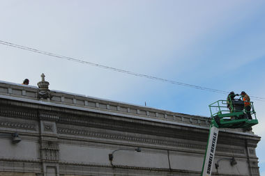 Crews at work dismantling the terra cotta on top of the Megamall.