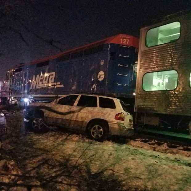 Two cars driven by a husband and wife are currently stuck on a Metra railroad line between North and Armitage Avenues in Bucktown near the Kennedy Expy., police and Metra officials said.