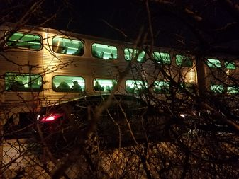 A sedan, one of two cars that stalled an outbound Metra train on Tuesday night.