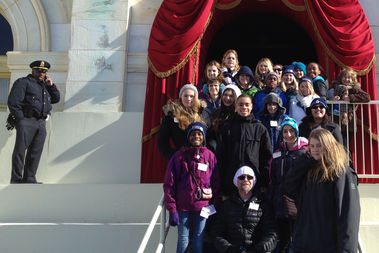 Teacher Jenny Vincent, in the center at the back, leads Alcott students in attending the second inaugural for President Barack Obama four years ago.