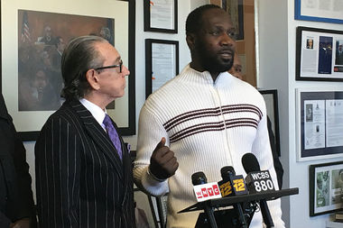 Mody Doucoure (left) speaks at a Tuesday press conference announcing a notice of claim for wrongful death against the city in the death of his brother-in-law Wali Camara, who was fatally shot after a man grabbed a gun from an officer's holster. The family is being represented by Sanford Rubenstein (left).