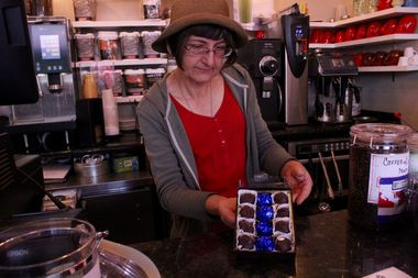 City News Cafe employee Donna Kosiba personally mixes and molds the truffles, selling more than 400 boxes since Dec. 9.