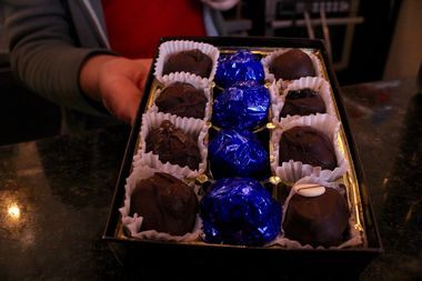 The middle row of each box is wrapped in blue foil to match the theme of the fundraiser.
