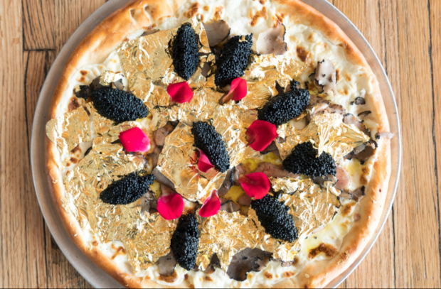 Gold flakes, foie gras and truffles top the exorbitantly priced pizza.