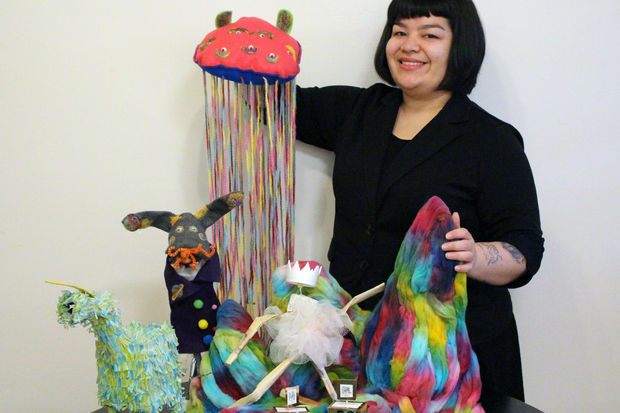 Chicago's Allyson Gonzalez with some of her puppets that she made.