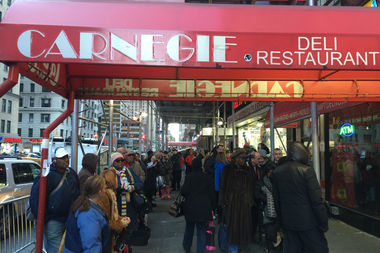 Pastrami lovers line up outside Carnegie Deli on its last day of business Friday.