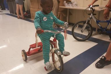 Christian Watts, 3, received a Radio Flyer tricycle.