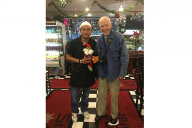 Bill Cunningham and Stage Star Deli manager Andre Garcia pose for photograph in December 2015.
