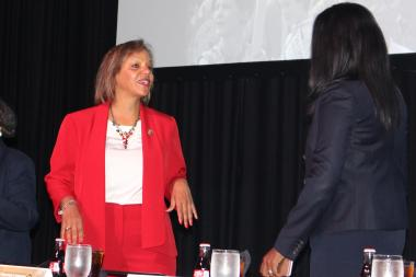 U.S. Rep. Robin Kelly talks with Democratic Cook County state's attorney candidate Kim Foxx before Hillary Clinton's appearance. Clinton cheered Kelly's role in a congressional sit-in on gun control.