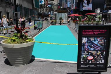 Times Square's designated activity zones are now 2 feet wider than they were last week.