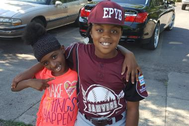 Sydnee Tinze, 8, (uniform) and her cousin are ready for the Englewood Police Youth Baseball League Opening Day.