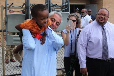 Mayor Rahm Emanuel indulges in a little horseplay with a youngster in the summer program at Kennicott Park.