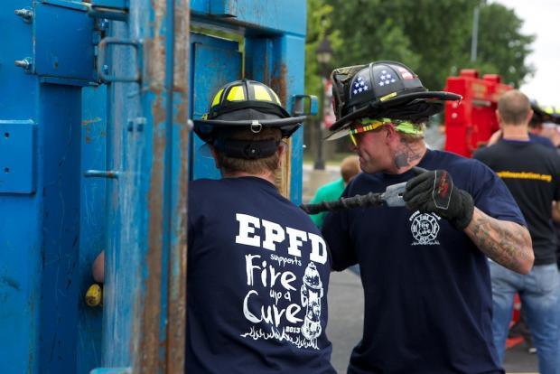 Teams of firefighters will compete in breaking down doors, eating hot wings, pulling fire trucks and other challenges as part of the FIre Up A Cure event July 30 at Saint Xavier University.