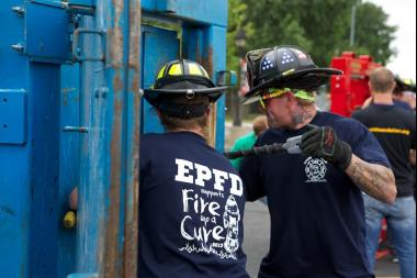 Teams of firefighters will compete in breaking down doors, eating hot wings, pulling fire trucks and other challenges as part of the FIre Up A Cure event Saturday at Saint Xavier University.