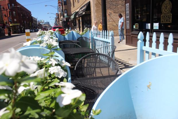 Lakeview's Clark Street corridor was the first in the city to get curbside cafes, an alternative to sidewalk cafes for streets with narrower walkways.