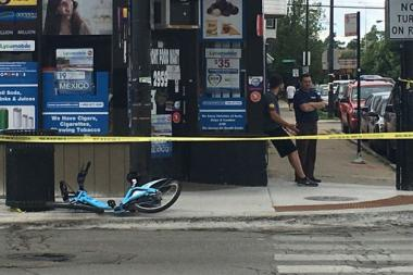 A Divvy cyclist was hit by a truck Friday morning at Belmont and Sacramento.