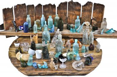 Unearthed bottles found during a dig in West Town.