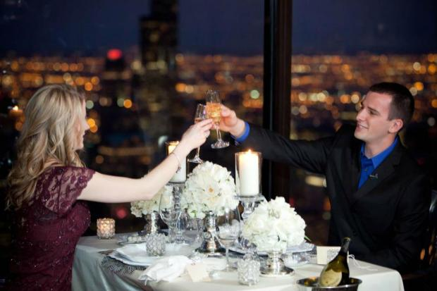 A couple celebrates their engagement at the Signature Room at the 95th.