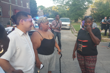 Ald. Raymond Lopez (15th) speaks to neighbors Tuesday at a corner meeting at 56th and Hermitage.