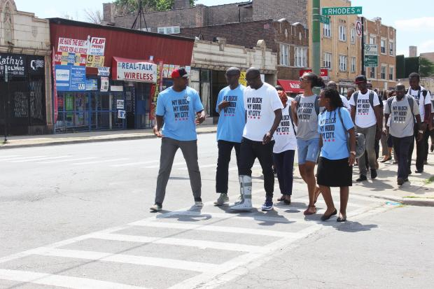 My Block My Hood My City group walks down 79th Street in Chatham with African entrepreneurs who are a part of the Young African Leaders Initiative Mandela fellowship.