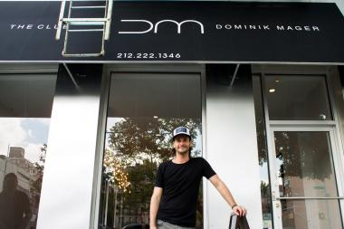 Dominik Mager stands in front of the newly opened hair salon,