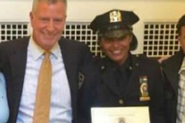 NYPD Detective Nancy Sola, who sped through stop signs with Mayor Bill de Blasio, seen with Hizzoner celebrating her recent promotion to second grade detective.