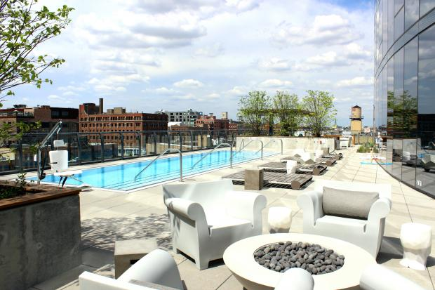 The Parker Fulton Market features an outdoor pool, sundeck and grassy area on the building's sixth floor.