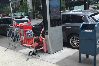 Valerie Mason saw a man sleeping in a plush recliner, plugged into a LinkNYC kiosk at East 49th Street and Third Avenue, on July 4.