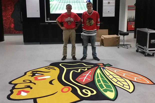 Wicker Park artist Chris Toepfer and his son William tour the Blackhawks locker room at United Center on Friday, July 8, 2016.