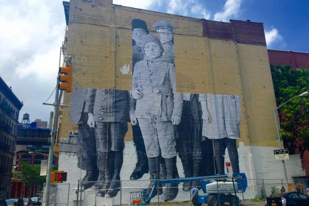 The massive pasting at 100 Franklin St.is a historic photo of children immigrants at Ellis Island.